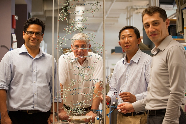 Scientists in the Essigmann lab — (left to right) Vipender Singh, John Essigmann, Deyu Li, and Bogdan Fedeles — scrutinize the structure of the DNA double helix, as they investigate the mechanism of mutagenesis of KP1212.