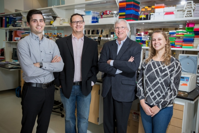 (Left to right) Miles Miller, Frank Gertler, Douglas Lauffenburger, and Madeleine Oudin in the Gertler Lab at MIT.