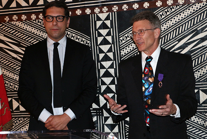Roger Wiens (right), leader of Los Alamos National Laboratory's ChemCam project, received the honorary title of knight in France's Academic Order of Palms. Christophe Lemoine (left), Consul General of France, presented him with the insignia. Credit: Photo courtesy of the Consulate General of France.