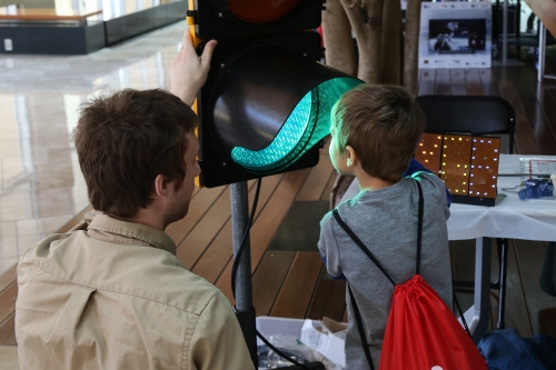 Photo: Visitors explored the concepts of light and wavelengths at the 2015 Wisconsin Science Festival's Discovery Expo. The Discovery Expo is a hands-on, family-friendly event that takes place in the Discovery Building over all four days of the festival.