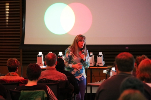 "Photo: Pupa Gilbert, a professor of physics at UW-Madison, presents the physics of color at the Nerd Nite event during the 2015 Wisconsin Science Festival. At the 2016 festival, Nerd Nite is a partner in the ""Science Storytellers Jam!"" that aims to engage audiences in science through creative storytelling."