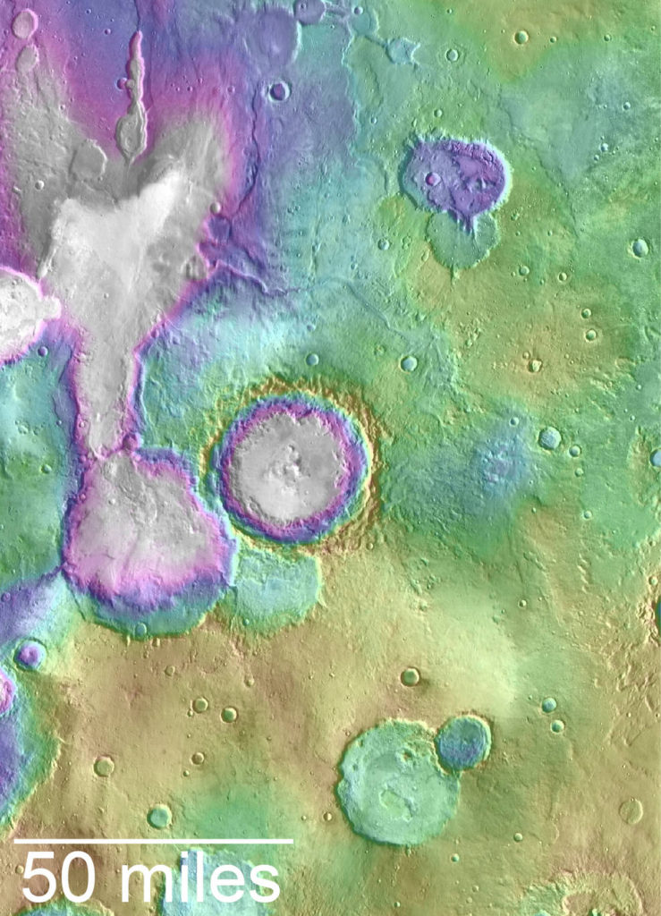 "Valleys much younger than well-known ancient valley networks on Mars are evident near the informally named ""Heart Lake"" on Mars. This map presents color-coded topographical information overlaid onto a photo mosaic. Lower elevations are indicated with white and purple; higher elevations, yellow. Credits: NASA/JPL-Caltech/ASU"