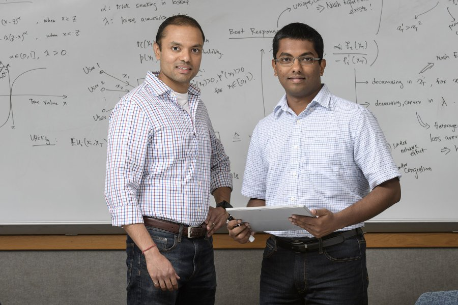 "Shreyas Sundaram, at left, an assistant professor in Purdue University's School of Electrical and Computer Engineering, and doctoral student Ashish Hota are performing research in game theory that harnesses the Nash equilibrium, developed by Nobel laureate John Nash, whose life was chronicled in the film ""A Beautiful Mind."" Credit: Purdue University photo/John Underwood"